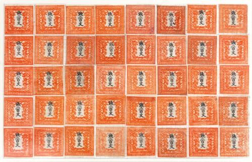 手嶋さんが200文切手のシートを復元しようと思い立ったのは、1点も完全なシートの現存が確認されていないため。根気強く切手を買い集めて完成させた。